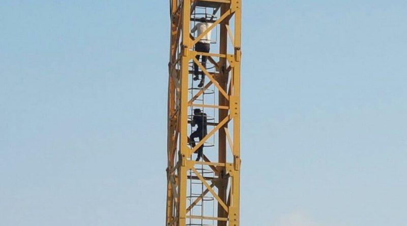 Upset Man Climbs Crane