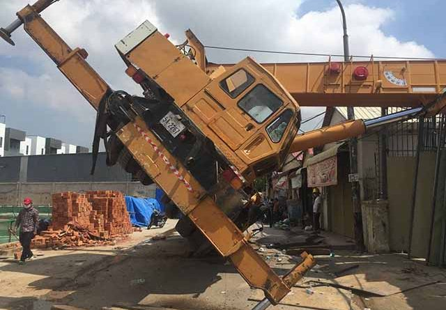 Tipped Crane Damages House